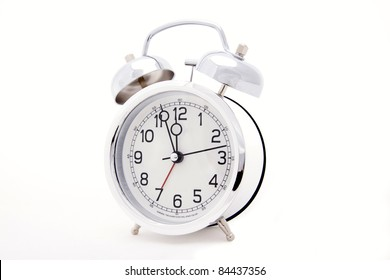 Clock with time approaching  midnight