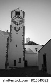 Clock tower in the ancient church from Santa Maria do Castelo in Tavira Portugal.