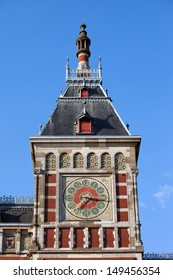 Clock tower of the Central Train Station in Amsterdam, Holland, Netherlands.