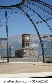 The Clock Tower of Gjirokastra Castle in Albania seen through the poles of the folklore festival stage on a sunny day