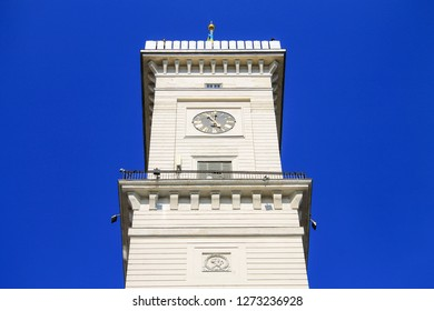 Clock Tower of Lviv City Hall.  Beautiful white old architecture of Lvov Town Hall on Rynok Square, Ukraine