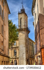 Clock tower of the old city hall of Aix-en-Provence, France seen from Rue Paul Bert
