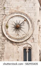 Clock tower of old stone church inside Diocletian City in Split, Croatia