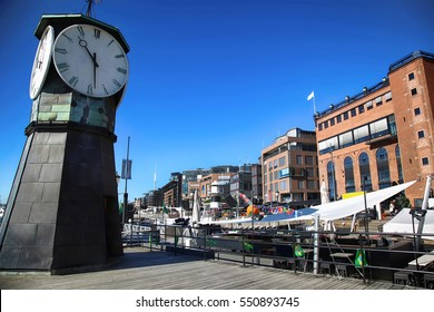 Clock tower on Aker Brygge Dock and modern building in Oslo, Norway