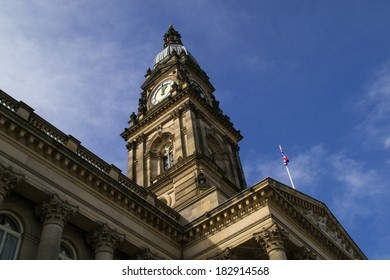 Clock tower on Bolton Town Hall in the English spring sun.