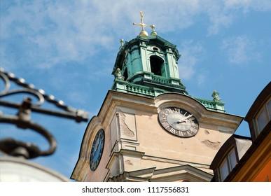 Clock tower on historical church Storkyrkan of Gamla Stan, Old Town in Sockholm, Sweden