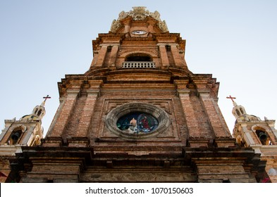 The clock tower of Our Lady of Guadalupe in Puerto Vallarta, Mexico