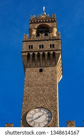 Clock Tower of the Palazzo Vecchio (1299) in Piazza della Signoria in downtown of Florence, UNESCO world heritage site in Tuscany, Italy, Europe