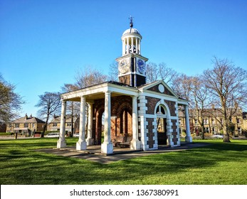 Clock Tower, Ravensknowle Park, Huddersfield, West Yorkshire, UK. Originally the entrance to the Cloth Hall of Huddersfield.