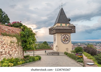 The Clock Tower situated on the top of Castle Hill in Graz, Austria in the sunset. The most famous landmark of the city was finished in 1560.  Graz is the capital city of the region of Steyr.