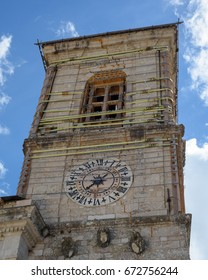 The clock tower of the Town Hall, Norcia, Italy, damaged by the October 2016 earthquake. Now bound together to make it safe prior to restoration.