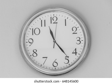 clock wall is isolated ,show number 1 -12 , white background of clock wall, white black image