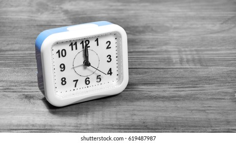 Clock watch time on table
