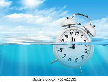 Clock in water, waste of time concept