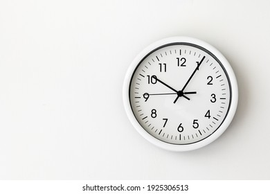 clock, white arrow clock on white background woman's hand holding a round clock with black hands, control, timing, time management, time, come, late, losing minutes, second