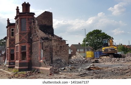 Clockface, ST Helens, Merseyside. UK. 07/15/2019 Green Dragon public house being demolished after a short period of being closed down before if was set alight and burnt down.