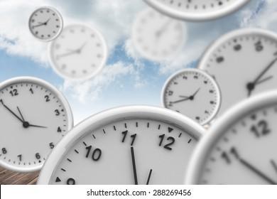 Clocks against cloudy sky background