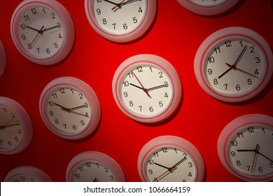 Clocks on a red background in a store