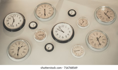 Lot of clocks on the wall.vintage tone.Wall decoration concept.