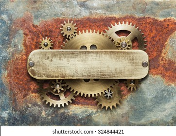 Clockwork mechanism on rusty background made of metal gears and brass plate.