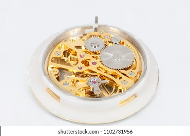 Clockwork mechanism of a pocket watch in gold, with jewels, close-up