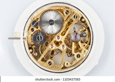 Clockwork mechanism of a pocket watch in gold, with jewels, close-up detail