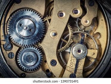 Clockwork old mechanical watch, high resolution and detail. Macro shot. Vintage clockwork background.