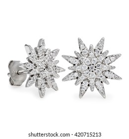 Cloes-up on pair silver stud earrings with diamonds in the form of star over white background with slight set down shadow