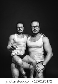 Cloning people concept. Creative man portrait. Black and white image with scratches