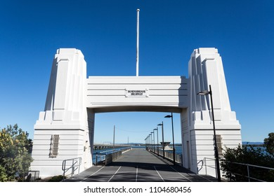 CLONTARF, AUSTRALIA – May 31, 2018:  Horizontal view of the Art Deco concrete abutment portal arch which frame the north end of the Hornibrook Bridge
