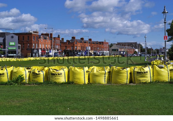 CLONTARF, DUBLIN, IRELAND - AUGUST 31, 2019: Large yellow sandbags as preventive flood protection. Disasters and their prevention. City life.