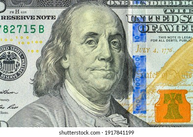 close up of a 100 dollar bill with Benjamin Franklin