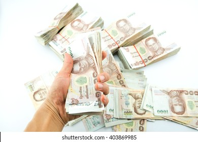 Close up of 1000 bath Thai money on hand : Thailand Currency 1000 Bath, BankNotes isolated on white background.