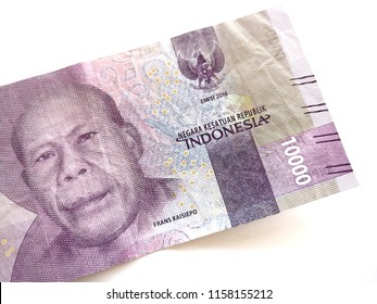 up close of 10000 rupiah Indonesia money with white background