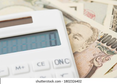 close up of 10000 yen and the calculator