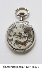 Close up of a 1865 French Pocket Watch mde out of Sterling Silver and Gold. The watch features a hand painted enamel dial depicting a winter scene.