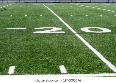 a close up of the 20 yard line on a artificial turf field