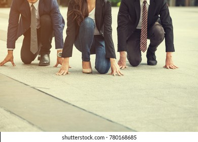 Close up of 20-30 year Old Business Man&Women Ready to Run at Start point. Business People Wearing a Suit,people Running the Race.who are Ready and Better are Winners, Business and Competition Concept