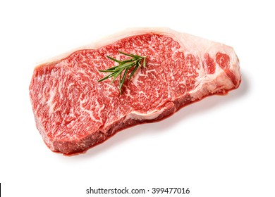 Close up 240 grams wagyu beef striploin steak with  rosemary isolated on white