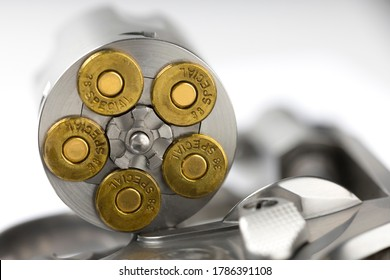 Close up of .38 special Bullets in revolver gun on white background