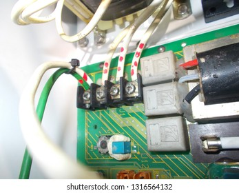 Close up of 440 volts electrical connections in a board, marked power connection of an eletronic board