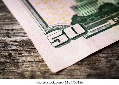 Close up of 50 Dollar bill on wooden table