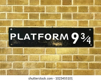 Close up of a 9 3/4 sign at Kings Cross Station.