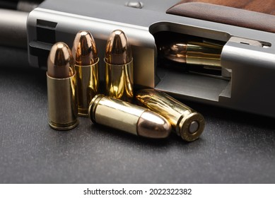 Close up of 9 mm. bullets with semi automatic pistol hand gun background , Pocket gun
