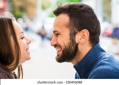 Close up .A man looks at a woman with love.they smile