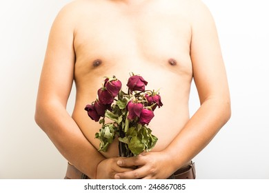 """Close up abdomen and withered rose on white background. concept """" Fat body side can make  rejects love """""""