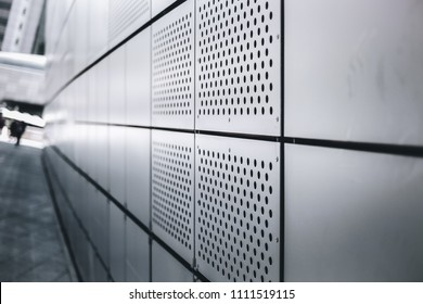 a close up abstract image of a surface texture of  gray aluminium composite panel setup as exterior of the modern building that make a nice perspective view