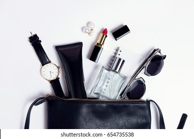 Close up accessories in cosmetic black bag top view .