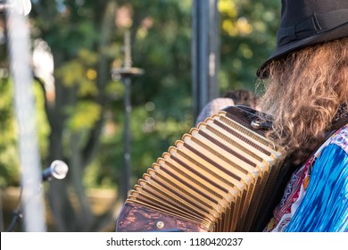 Close up of accordion and accordion player playing at a Klezmer Jewish music concert in Regent's Park in London UK.