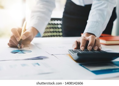 Close up Accountant or Bookkeeper calculate tax information or business data. Businessman working in office